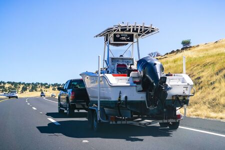 June 26, 2019 Oakdale  CA  USA - Truck towing a  boat on the freeway