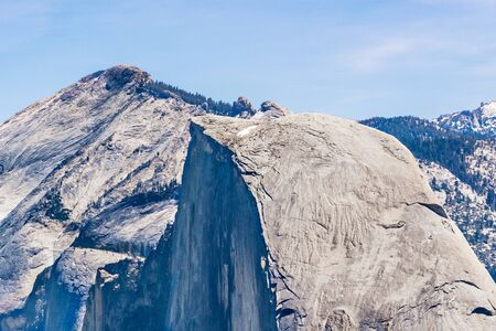 View towards the top of Half Dome in Yosemite National Park; Clouds Rest peak visible in the background, Sierra Nevada mountains, California