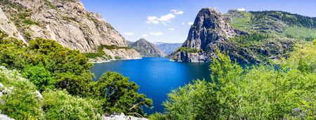 Panoramic view of Hetch Hetchy reservoir; Yosemite National Park, Sierra Nevada mountains, California; the reservoir is one of the main sources of drinking water for the San Francisco bay area