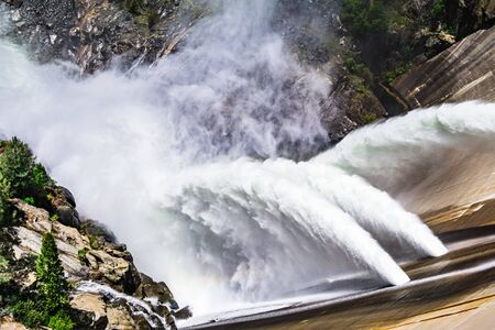 Water release at O'Shaughnessy Dam due to high levels of snow melt at Hetch Hetchy Reservoir in Yosemite National Park; One of the main sources of drinking water for San Francisco Bay, California