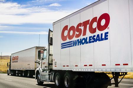 June 28, 2019 Stockton  CA  USA - Branded Costco Wholesale trucks driving on the freeway