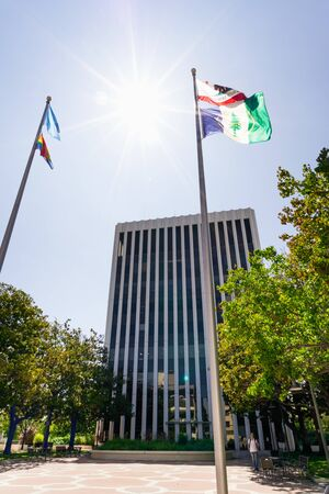 July 26, 2019 Palo Alto  CA  USA - Palo Alto City Hall building and the flags rased in front of it; San Francisco Bay area