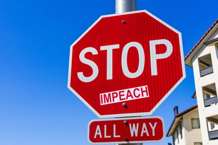 Impeach sticker applied on a Stop traffic sign; San Francisco bay area, California