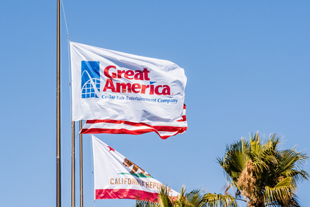 August 1, 2019 Santa Clara  CA  USA - Californias Great America amusement park flag waving in the wind; South San Francisco Bay area; owned and operated by Cedar Fair Editorial