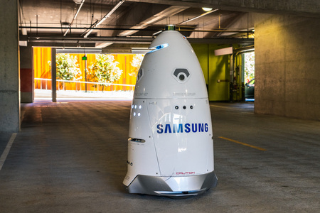 August 1, 2019 San Jose  CA  USA - Knightscope security robot branded with the Samsung logo patrolling the parking lot of the Samsung Semiconductor offices, Silicon Valley