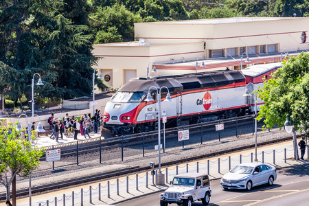 July 30, 2019 Palo Alto  CA  USA - Caltrain, a local railway transportation service, arriving at the Palo Alto station in Silicon Valley