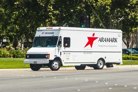 August 1, 2019 Sunnyvale  CA  USA - Aramark vehicle making deliveries in South San Francisco bay area; Aramark Corporation is an American food service, facilities, and uniform services provider Editorial