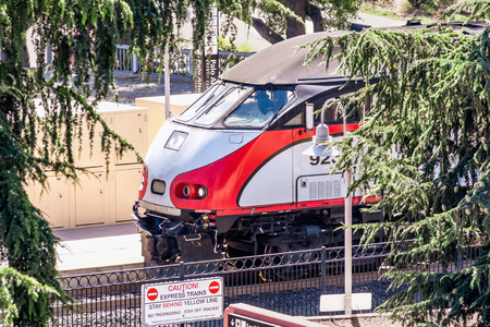 July 30, 2019 Palo Alto  CA  USA - Close up of the front part of a Caltrain locomotive, a local railway transportation service, arriving in the Palo Alto station in Silicon Valley