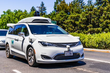 July 2, 2019 Mountain View  CA  USA - Waymo self driving car performing tests on a street near Googles headquarters, Silicon Valley; Waymo, a subsidiary of Alphabet, is developing an autonomous car Editorial