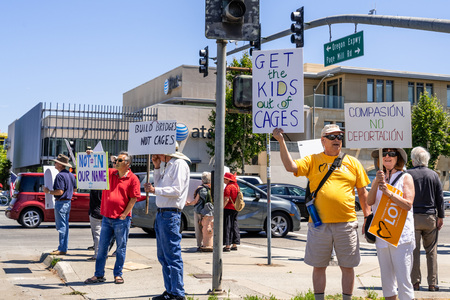 July 26, 2019 Palo Alto  CA  USA - People protesting on a street against the current policy of family separation Editorial