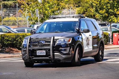 July 26, 2019 Palo Alto  CA  USA - Police car driving on the street, close to downtown Palo Alto, San Francisco bay area