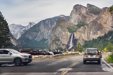 June 27, 2019 Yosemite National Park  CA  USA - Tourists gathered at the Tunnel View vista point; Bridalveil Fall and Half Dome visible in the background Editorial
