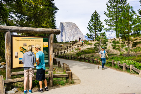 June 27, 2019 Yosemite National Park  CA  USA - Unidentified people visiting Glacier Point; Half Dome visible in the background