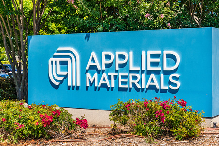 July 24, 2019 Santa Clara / CA / USA - Applied Materials sign posted at the entrance to the Company's campus in Silicon Valley, South San Francisco bay area Banco de Imagens - 128407190