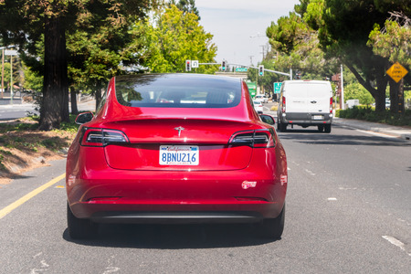 August 5, 2019 Mountain View  CA  USA - Rear view of red Model 3 Tesla driving on a highway in South San Francisco bay area Editorial