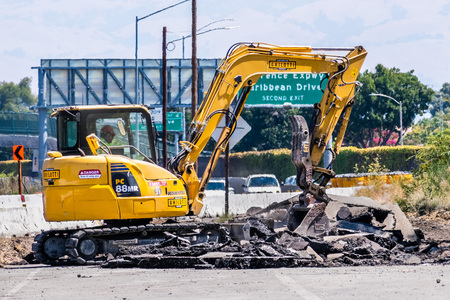 August 7, 2019 Sunnyvale  CA  USA - Excavator demolishing a freeway exit in South San Francisco bay area