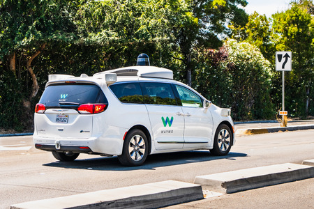 August 8, 2019 Palo Alto / CA / USA - Waymo self driving car performing tests on a street in Silicon Valley; Waymo, a subsidiary of Alphabet (and Google parent co), is developing an autonomous car Standard-Bild - 128407230