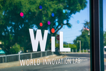 July 26, 2019 Palo Alto / CA / USA - World Innovation Lab logo on the theirs offices windows in Silicon Valley; WIL is a venture capital firm that invests in consumer and enterprise tech companies Standard-Bild - 128407232