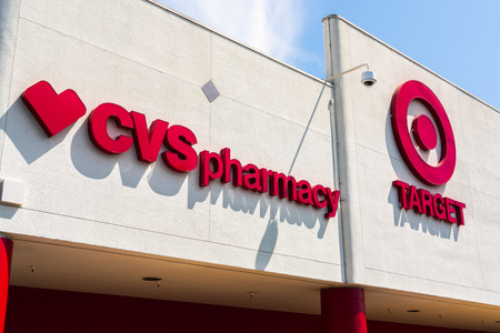 July 30, 2018 Cupertino / CA / USA - Close up of CVS Pharmacy logo displayed alongside the Target Bullseye symbol;  CVS Health acquired Target Corporation's pharmacy and retail clinic businesses Standard-Bild - 128407236