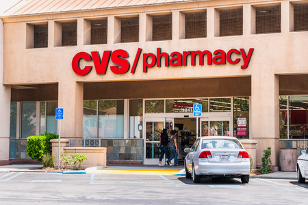 August 5, 2019 Mountain View / CA / USA - People shopping at CVS / pharmacy; CVS Pharmacy is a subsidiary of the American retail and health care company CVS Health Banco de Imagens - 128407241