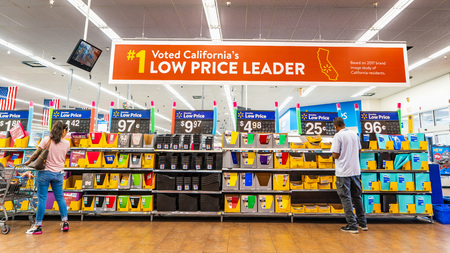August 8, 2019 Mountain View / CA / USA - People shopping for back to school items in one of the Walmart stores; Banner advertising the low price leader status in California displayed above