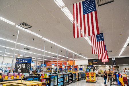 August 8, 2019 Mountain View / CA / USA - American flags displayed in an Walmart store close to the entrance; The