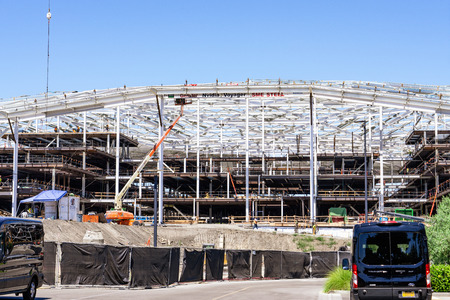 August 9, 2019 Santa Clara / CA / USA - The new, massive Nvidia Voyager building under construction at the company's corporate campus in Silicon Valley, South San Francisco bay area Standard-Bild - 128407258