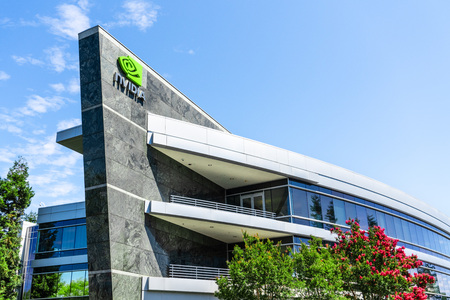 August 9, 2019 Santa Clara / CA / USA - One of the Nvidia office buildings located in the Company's campus in Silicon Valley; the NVIDIA logo and symbol displayed on the facade Banco de Imagens - 128407264