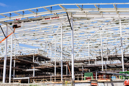August 9, 2019 Santa Clara / CA / USA - The new, massive Nvidia Voyager building under construction at the company's corporate campus in Silicon Valley, South San Francisco bay area Banco de Imagens - 128407266