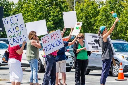 August 5, 2019 Palo Alto / CA / USA - People protesting on a street in downtown Palo Alto against the current policy of family separation