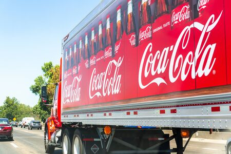August 23, 2019 Sacramento  CA  USA - Coca Cola truck driving on the interstate;  Coca Cola logo printed on the side