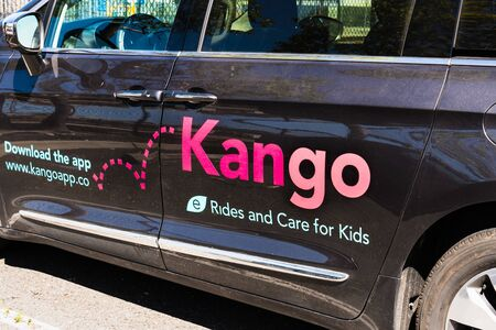 August 15, 2019 San Mateo  CA  USA - Close up of Kango logo on the door of one of the Companys cars; Kango is a kids' ride-hail app that doubles as a childcare service operating in Silicon Valley