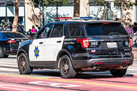 August 21, 2019 San Francisco  CA  USA - SFPD vehicle driving on Market Street in downtown San Francisco