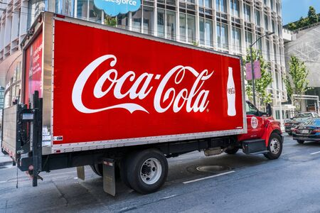 August 21, 2019 San Francisco  CA  USA - Coca Cola truck driving on a street in downtown San Francisco; SOMA District Editorial