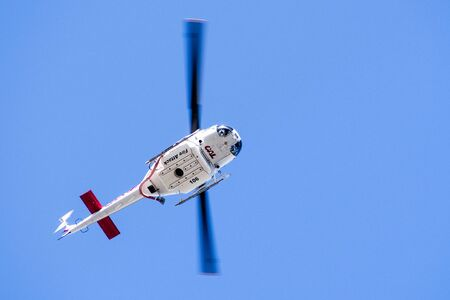 Sep 23, 2019 Santa Clara / CA / USA - Cal Fire (California Department of Forestry and Fire Protection) helicopter responding to an emergency call in South San Francisco Bay Area
