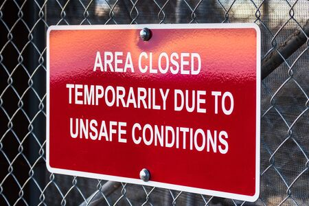 'Area closed temporarily due to unsafe conditions' posted sign