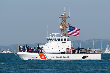 Oct 12, 2019 San Francisco / CA / USA - U.S. Coast Guard ship cruising in the San Francisco Bay during the 39th Fleet Week event