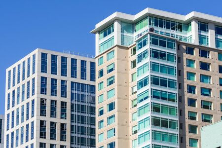 Exterior view of multifamily residential building, next to an office building; South of Market District, San Francisco