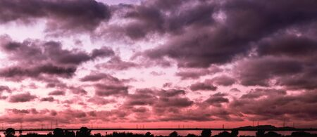 Panoramic view of purple and red sunset clouds covering the sky; South San Francisco Bay Area, Sunnyvale, California