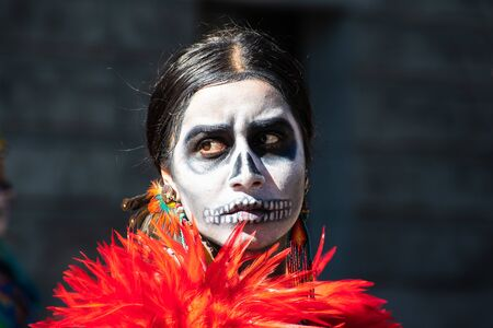 Oct 20, 2019 San Jose / CA / USA - Portrait of a woman with sugar-skull make-up, participating at Dia de Los Muertos (Day of the Dead) procession taking place in South San Francisco Bay