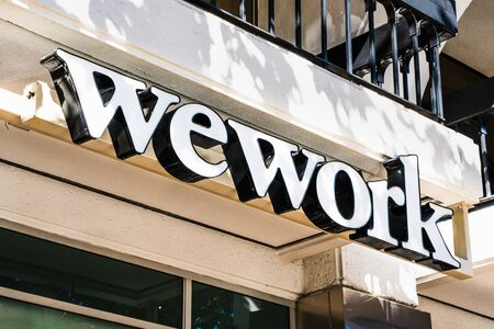 Oct 20, 2019 San Jose  CA  USA - WeWork logo at on of their office buildings located in Silicon Valley; WeWork is an American company that provides shared work spaces