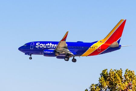 Oct 9, 2019 San Jose  CA  USA - Southwest Airlines aircraft approaching Norman Y. Mineta San Jose International Airport and preparing for landing; blue sky background