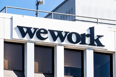 Oct 18, 2019 Berkeley  CA  USA - Close up of WeWork sign displayed on the building offering co-working office space in downtown; WeWork is an American company that provides shared work spaces