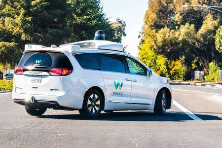 Oct 26, 2019 Sunnyvale / CA / USA - Waymo self driving car performing tests on a street near Google's offices, Silicon Valley; Waymo, a subsidiary of Alphabet, is developing an autonomous car Editorial
