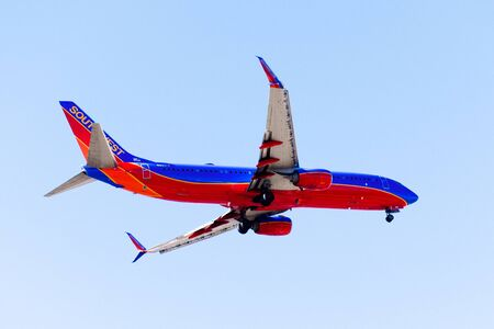 Oct 20, 2019 San Jose  CA  USA - Southwest Airlines aircraft approaching Norman Y. Mineta San Jose International Airport and preparing for landing; blue sky background Editorial