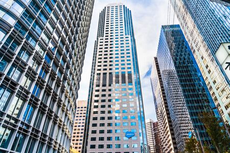 Oct 26, 2019 San Francisco  CA  USA - Salesforce West tower displaying the Companys logo, surrounded by Salesforce Tower on the left and Salesforce East and Millennium Towers on the right;