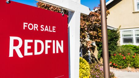 Nov 1, 2019 Santa Clara  CA  USA - Redfin sign posted in front of a house for sale; Redfin is a real estate brokerage whose business model is based on sellers paying Redfin a small fee