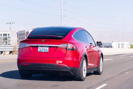 Oct 27, 2019 San Jose  CA  USA - Tesla Model X travelling on the freeway in Silicon Valley; South San Francisco bay area