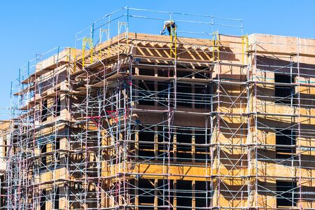 Multifamily residential building under construction in Sunnyvale; the entire Silicon Valley and San Francisco Bay Area has faced a housing crisis, with increased housing costs, for several years