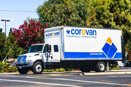 Aug 22, 2019 Santa Clara  CA  USA - Corovan truck driving on a street; Corovan is a commercial moving and storage services company based in California